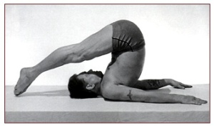 Joseph Pilates performing Roll Over